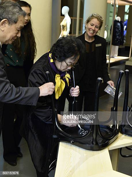 Tu Youyou of China Academy of Traditional Chinese Medicine in Beijing and Nobel Physiology prize or Medicine prize colaureate signs a chair at the...