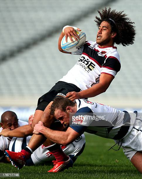 Tua Saseve of North Harbour is tackled by Luke Braid of Auckland during the round one ITM Cup match between Auckland and North Harbour at Eden Park...