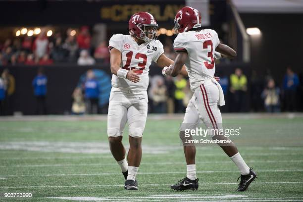 Tua Tagovailoa and Calvin Ridley of the Alabama Crimson Tide celebrate a touchdown against the Georgia Bulldogs during the College Football Playoff...