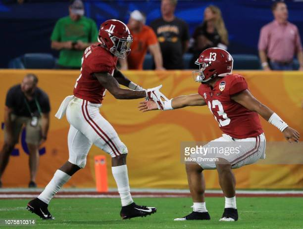 Tua Tagovailoa and Henry Ruggs III of the Alabama Crimson Tide celebrate the touchdown in the first quarter during the College Football Playoff...