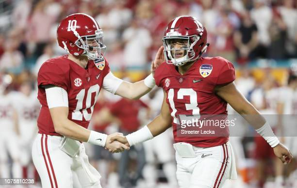 Tua Tagovailoa and Mac Jones of the Alabama Crimson Tide celebrate the touchdown in the first quarter during the College Football Playoff Semifinal...
