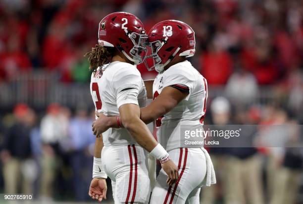 Tua Tagovailoa celebrates a touchdown pass with Jalen Hurts of the Alabama Crimson Tide during the third quarter against the Georgia Bulldogs in the...