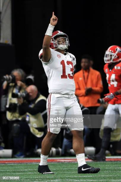 Tua Tagovailoa of the Alabama Crimson Tide celebrates a six yard touchdown pass during the third quarter against the Georgia Bulldogs in the CFP...