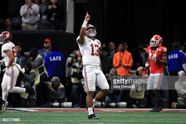 Tua Tagovailoa of the Alabama Crimson Tide celebrates a six yard touchdown pass during the third quarter against the Georgia Bulldogs in the CFP...