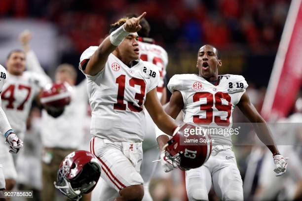 Tua Tagovailoa of the Alabama Crimson Tide celebrates beating the Georgia Bulldogs in overtime to win the CFP National Championship presented by ATT...