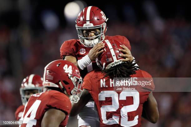 Tua Tagovailoa of the Alabama Crimson Tide celebrates with Najee Harris after his oneyard touchdown run in the second quarter of the game against the...