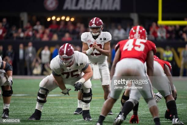 Tua Tagovailoa of the Alabama Crimson Tide commands the offense against the Georgia Bulldogs during the College Football Playoff National...