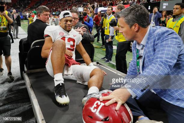 Tua Tagovailoa of the Alabama Crimson Tide is carted off the field after defeating the Georgia Bulldogs 3528 in the 2018 SEC Championship Game at...