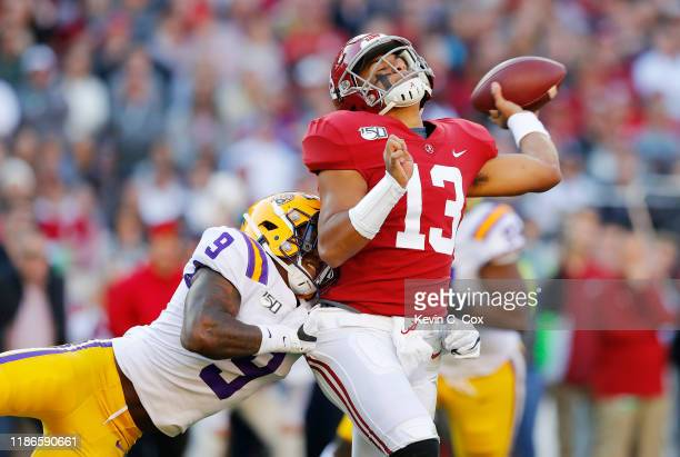 Tua Tagovailoa of the Alabama Crimson Tide is hit by Marcel Brooks of the LSU Tigers as he throws the ball during the first half in the game at...