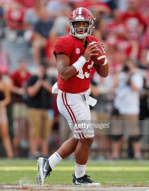Tua Tagovailoa of the Alabama Crimson Tide looks to pass against the Arkansas State Red Wolves at BryantDenny Stadium on September 8 2018 in...