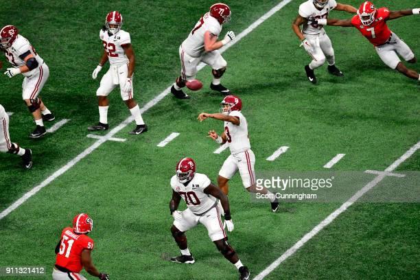Tua Tagovailoa of the Alabama Crimson Tide passes against the Georgia Bulldogs in the CFP National Championship presented by ATT at MercedesBenz...