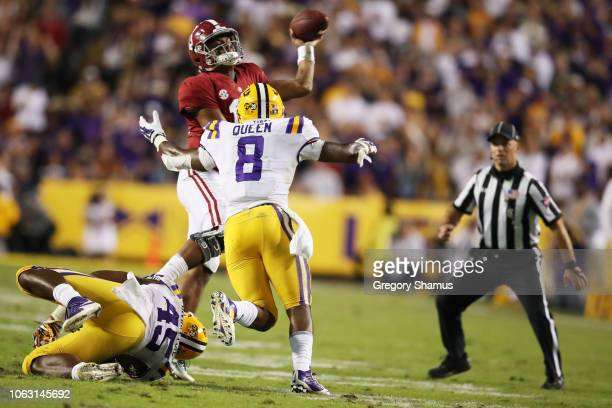 Tua Tagovailoa of the Alabama Crimson Tide passes under pressure by Michael Divinity Jr #45 and Patrick Queen of the LSU Tigers in the second quarter...