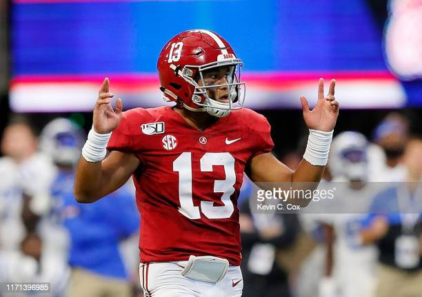 Tua Tagovailoa of the Alabama Crimson Tide reacts after passing for a touchdown in the first half against the Duke Blue Devils at MercedesBenz...
