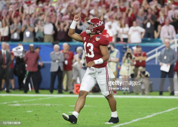 Tua Tagovailoa of the Alabama Crimson Tide reacts after the touchdown in the first quarter during the College Football Playoff Semifinal against the...