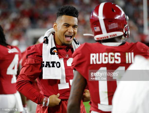 Tua Tagovailoa of the Alabama Crimson Tide reacts on the sidelines in the first half against the Arkansas Razorbacks with Henry Ruggs III at...