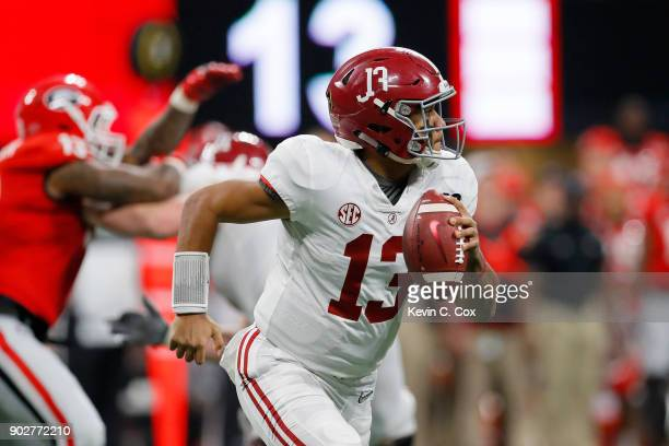 Tua Tagovailoa of the Alabama Crimson Tide rolls out on a pass play during the third quarter against the Georgia Bulldogs in the CFP National...