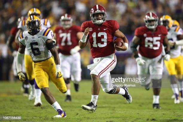 Tua Tagovailoa of the Alabama Crimson Tide runs for a third quarter touchdown while playing the LSU Tigers at Tiger Stadium on November 3 2018 in...
