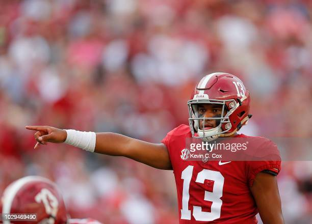 Tua Tagovailoa of the Alabama Crimson Tide runs the offense against the Arkansas State Red Wolves at BryantDenny Stadium on September 8 2018 in...