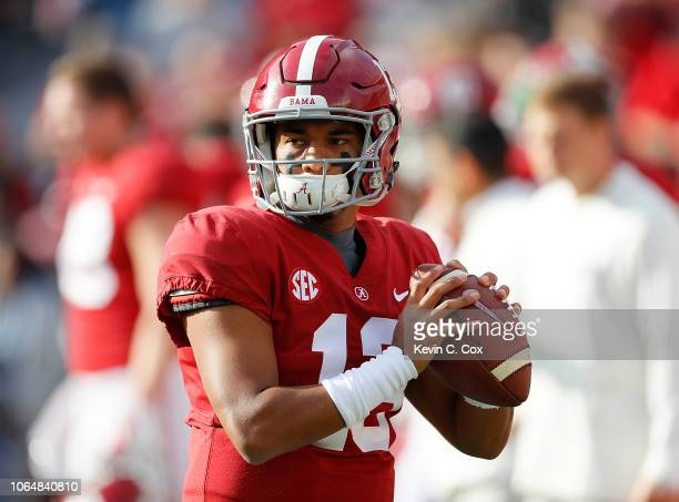 Tua Tagovailoa of the Alabama Crimson Tide runs through warmups prior to facing the Auburn Tigers at BryantDenny Stadium on November 24 2018 in...