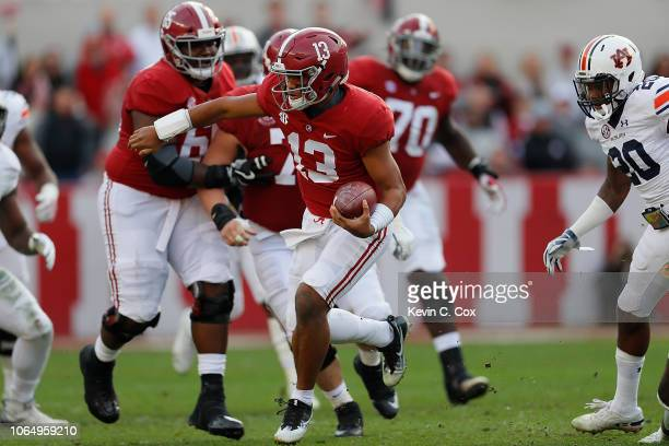 Tua Tagovailoa of the Alabama Crimson Tide rushes against the Auburn Tigers at BryantDenny Stadium on November 24 2018 in Tuscaloosa Alabama