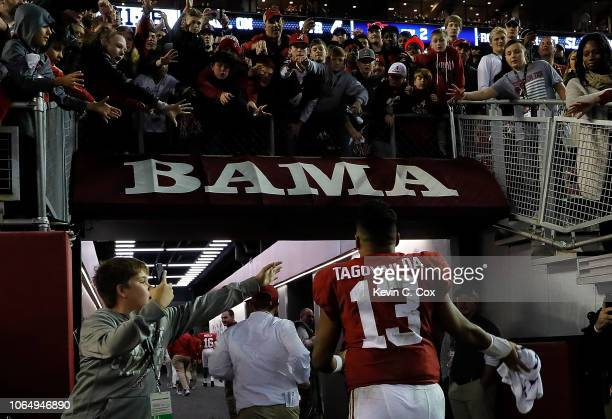 Tua Tagovailoa of the Alabama Crimson Tide rushes off the field after their 5221 win over the Auburn Tigers at BryantDenny Stadium on November 24...