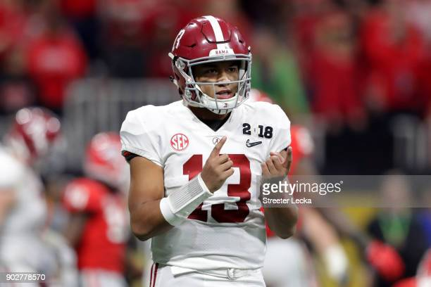 Tua Tagovailoa of the Alabama Crimson Tide signals to his sideline during the second half against the Georgia Bulldogs in the CFP National...