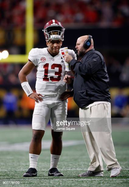 Tua Tagovailoa of the Alabama Crimson Tide speaks to Brian Daboll, the offensive coordinator, on the sidelines during the second half against the...