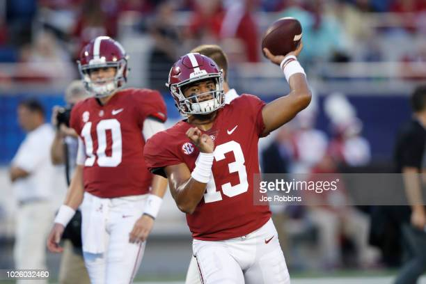 Tua Tagovailoa of the Alabama Crimson Tide warms up prior to the game against the Louisville Cardinals at Camping World Stadium on September 1 2018...