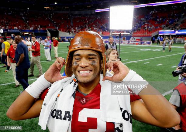 Tua Tagovailoa of the Alabama Crimson Tide wears the Old Leather Helmet after their 423 win over the Duke Blue Devils at MercedesBenz Stadium on...