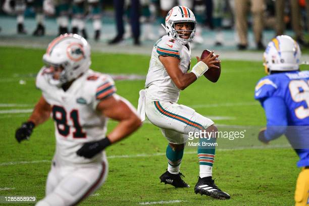 Tua Tagovailoa throws a touchdown pass to Durham Smythe of the Miami Dolphins against the Los Angeles Chargers during the second half at Hard Rock...