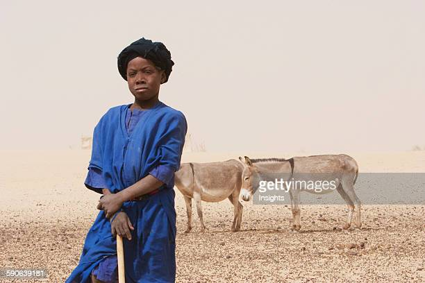 Tuareg boy standing with donkeys in the background Nibka Mohammed Mali