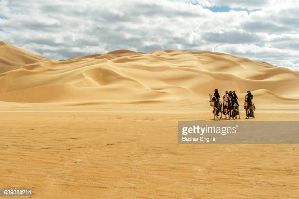 tuareg camels riders - sahara stock pictures, royalty-free photos & images