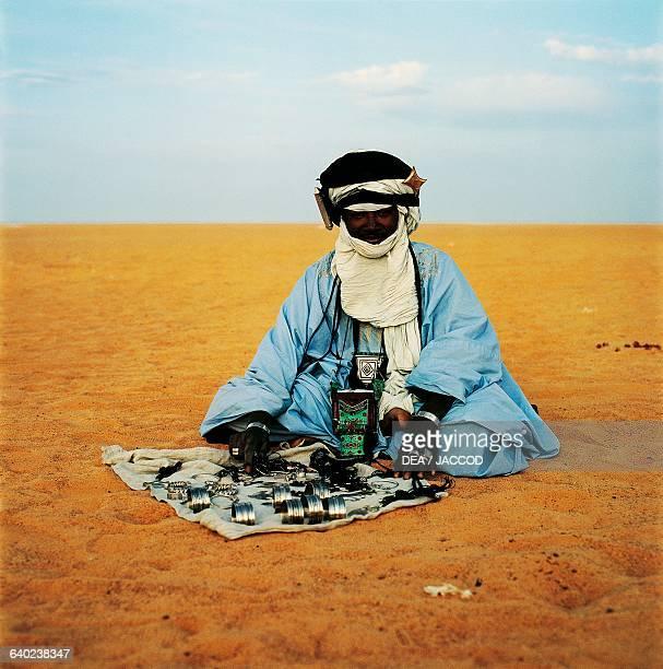 Tuareg jewelry seller Assamakka border with Algeria Agadez region Niger