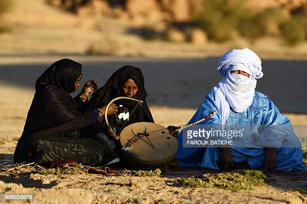 Tuareg Khoulene Alamine an imzad teacher sits with a poet on the sand of the Tagmart plateau around 30 kilometres outside Tamanrasset in Southern...
