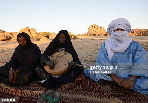Tuareg Khoulene Alamine , an imzad teacher sits with a poet on the sand of the Tagmart plateau, around 30 kilometres outside Tamanrasset in Southern...