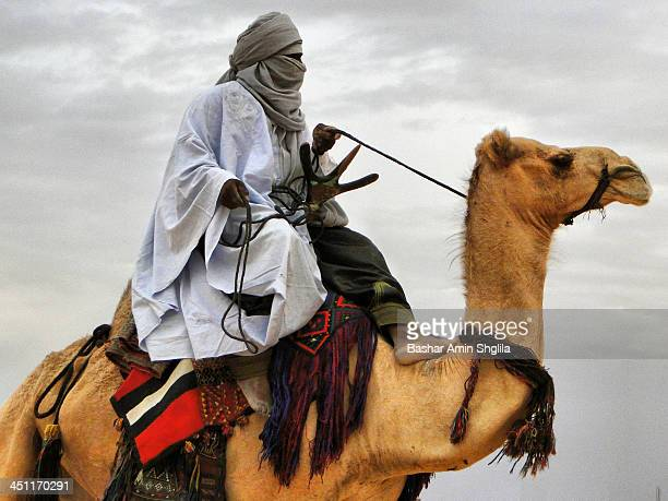 CONTENT] Tuareg knight riding his Camel at the Libyan Desert near of darj City