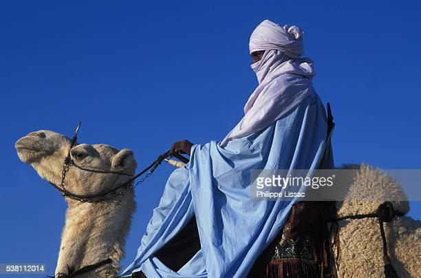 Tuareg Man Riding Camel