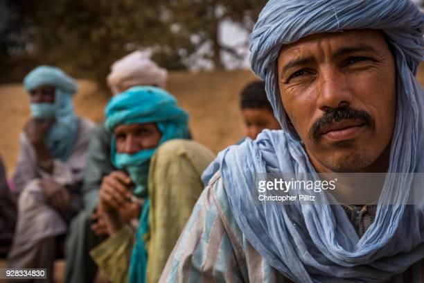 Group of Tuareg heardsmen sit in a circle in conversation in wadi Tidene, central Niger.