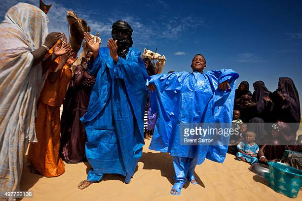 Tuareg Nomads end the Ramadan fast in the desert about 50 kilometers outside of Timbuktu with prayer and dancing on September 21 2009 in Mali