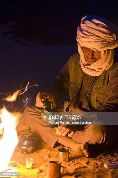 Tuareg preparing tea on a camp fire, Tadrat, Tassili n'Ajjer, Algeria, North Africa, Africa