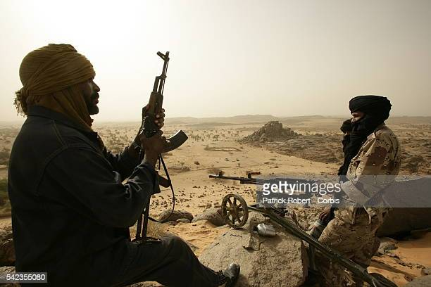 Tuareg rebels patrolling near their camp of Tigha, located in the north of Kidal. In March 2006, Malian army officer Hassan ag Fagaga, of Tuareg...