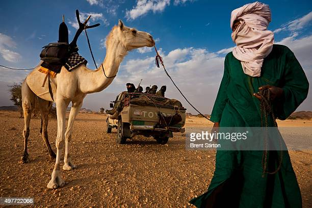 Tuareg soldiers of the MNJ 'The Movement for Justice in Niger' move on after consulting with a Tuareg nomad as to the whereabouts of their enemy the...