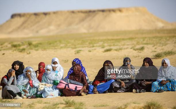 Tuareg tribeswomen attend a traditional ceremony in the Libyan desert in the western Awal region near the borders with Tunisia and Algeria, about 600...