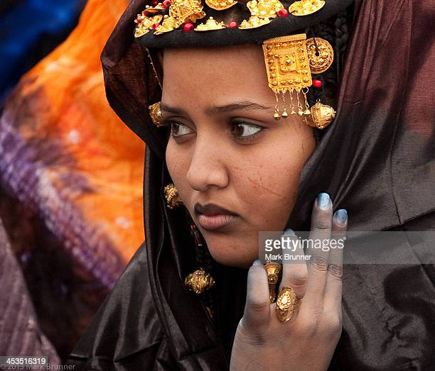 Tuareg woman in full festival dress at the Festival Au Desert near essakane, Mali. Essakane is about 40 miles out of Timbuctou in northern mali....