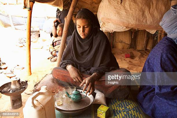 Tuareg woman preparing mint tea in Tiriken Mali