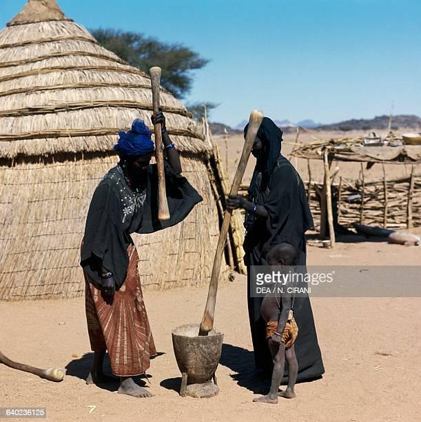 Tuareg women pounding millet Iferouane oasis Air mountains Agadez region Niger