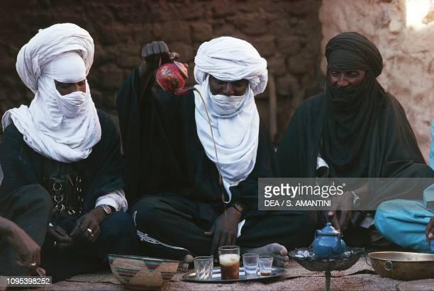 Tuaregs drinking tea, Oasis of Timia, Air and Tenere Nature Reserve , Niger.