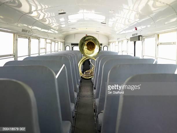Tuba across aisle in school bus