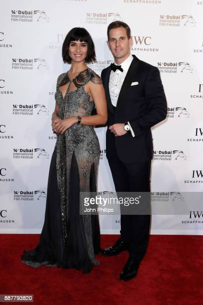 Tuba Buyukustun and IWC Schaffhausen CEO Christoph GraingerHerr attend the sixth IWC Filmmaker Award gala dinner at the 14th Dubai International Film...