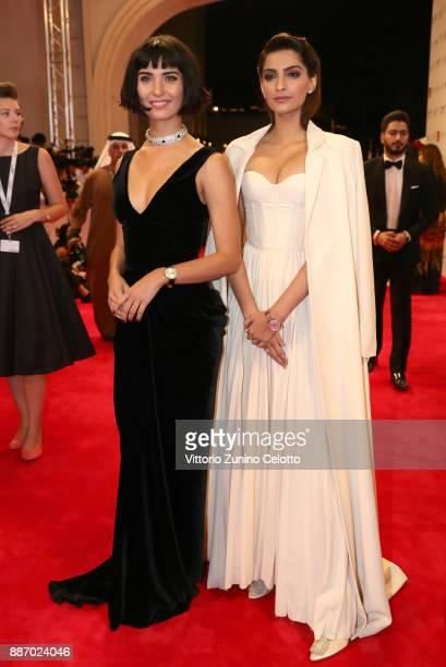 Tuba Buyukustun and Sonam Kapoor attends the Opening Night Gala of the 14th annual Dubai International Film Festival held at the Madinat Jumeriah...